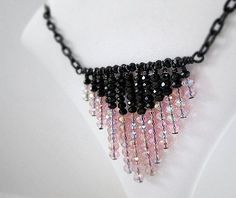 This pink and black necklace created by Jewelry by CARMAL is made of: -Pink faceted crystal rondelles -Black faceted crystal rondells -Black metal link chain -Black metal head pins -Black metal wire -Black metal jump rings -Black metal spring ring clasp closure This pink and black #metalwirerings