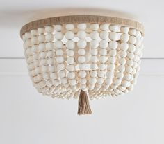 beaded light fixture a gorgeous collection of stylish flush mount light fixtures the collection focuses on scallop star bead and industrial pieces wood beaded light fixture Pottery Barn Kids, Pottery Barn Hacks, Pottery Barn Nursery, Pottery Barn Inspired, Nursery Lighting, Kids Lighting, Boho Lighting, Lighting Ideas, Industrial Lighting