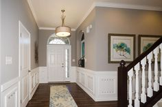 Model Home Foyer Pictures : Stunning light fixtures make dress up this hallway #chandeliers