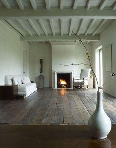 Axel Vervoordt, flooring Linen sofa with a rustic timber floor#linensofa