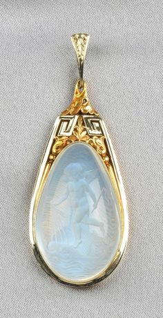 Moonstone Intaglio Pendant, the moonstone drop depicting a cherub riding dolphins within an 18kt bicolor gold mount with Greek key and foliate motifs