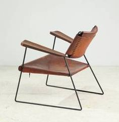 Rare Studio Furniture Chair with Heavy Saddle Leather | 1stdibs.com