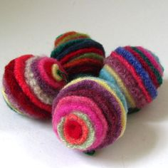 I made these charming little balls from upcycled wool sweaters. I wash the sweaters in hot water using scent free soap and dry them in a hot drier.