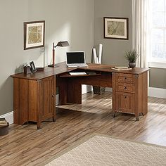 Add some style to your office or home office while saving space with a corner desk. This l shaped desk fits nicely into a corner, giving you plenty of work space and storage. Features of this office desk include:   Slide-out keyboard/mouse shelf with metal runners and safety stops. Three drawers feature patented T-lock assembly system