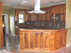 Pecky Cypress kitchen cabinets in rustic style. I love the honey color on these. . .would definitely go with my breakfast table!
