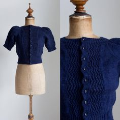 "1940s hand knitted and dyed midnight blue wool sweater with puff sleeves (I did not have to puff these sleeves on the mannequin - they are super poofy on their own). Condition is mint, sweater doesn't look worn. Bust 16 1/2"" + some stretch, Waist 12"" + some stretch, Shoulders 16.3"" including puff, Length 16 1/2"". DM for more photos or to purchase!"
