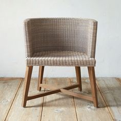 """Made from lightweight, synthetic rattan, this contemporary chair was designed and crafted especially for terrain. Teak legs finished with our Instant Grey + Teak Shield finish assure outdoor durability.- A terrain exclusive- Teak wood, Instant Grey + Teak Shield finish, polyrattan- Indoor or outdoor use- Treat legs seasonally with Teak Shield - Clean wicker with mild soap and water- Seat: 16.5""""H, 18.5""""D- Arm: 10.25""""H- Please note: cushion is not included- Imported30.3""""H, 26.4""""W, 23.6""""D"""