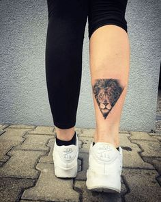 Small Lion King on Bottom Leg Tattoo