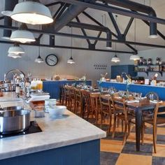 The Soho FarmHouse Cookery Workshop Kitchen. Reclaimed industrial factory pendant lights.