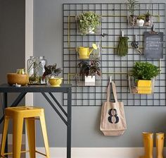 Hang kitchen baskets on a mounted wall trellis and fill with plants for an indoor vertical garden. ways to decorate a rental on a budget. Also has a genius idea for hanging posters with tape! Interior Design Trends, Home Design, Modern Interior, Design Ideas, Wall Design, Studio Interior, Interior Ideas, Kitchen Baskets, Kitchen Decor