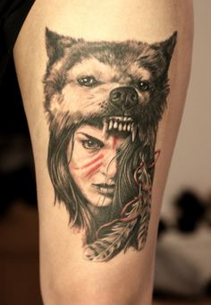 Realistic black and grey warrior girl portrait with a wolf headdress tattoo