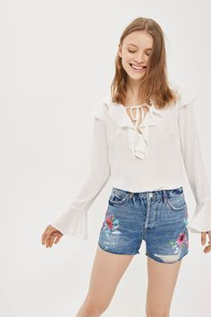Borrow from the boys in shape and up-the-ante on denim cut-offs with these edgy ripped Ashley shorts. Cut with a mid-rise waist, they're detailed with a raw hem and rips for an edgy feel, and colourful floral paintwork for a pretty contrast.