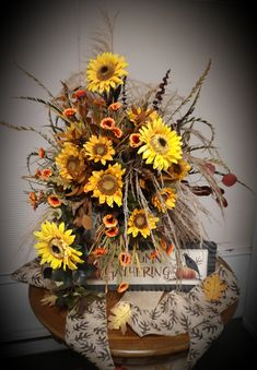 Fall sunflowers and preserved leaves and grasses. A perfect display piece for your home this Fall! Sunflower Arrangements, Corsage And Boutonniere, Grasses, Sunflowers, Event Design, Custom Homes, Floral Design, Leaves, Display