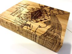 This is a box designed to look like a book. In the book theme I designed the box to look like a book with the Marauders Map as the cover