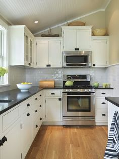 White Cabinets With Black Countertop Design. Love the door/drawer handles.
