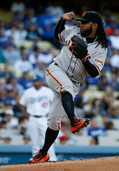 . San Francisco Giants starting pitcher Johnny Cueto watches a pitch to the Los Angeles Dodgers during the first inning of a baseball game in Los Angeles, Saturday, April 16, 2016. (AP Photo/Chris Carlson)