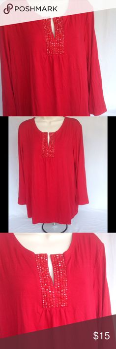 Sequins Red Top Delicious red top with slit on chest with sequins. NWOT never worn. Check out other items for a bundle discount. PRICE FIRM UNLESS BUNDLED. Tops Blouses
