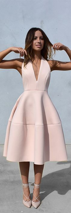 Why not try something like an a-line soft pink midi dress with that plunging v-neckline and a neutral heel as opposed to the everyday LBD? So, cute.
