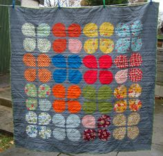 grumpystitches:  http://www.charmaboutyou.com/2012/11/retro-flowers-quilt.html