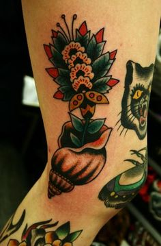 By Christos Triantifilou #traditional #tattoo #conch #flower