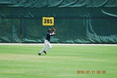 Tracking down a fly ball at the Perfect Game Showcase in East Cobb, GA.; circa 2012.