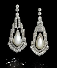A pair of art deco natural pearl and diamond pendent earrings, circa 1925 Each old brilliant-cut diamond surmount suspending an articulated chandelier pendant, pierced and set with old brilliant, single and rose-cut and half-moon-shaped diamonds, with a c Art Deco Jewelry, Pearl Jewelry, Antique Jewelry, Vintage Jewelry, Fine Jewelry, Jewelry Design, Antique Earrings, Art Deco Fashion, Fashion Jewelry