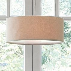 "Simple, sophisticated design and neutral coloring make this go-anywhere pendant lamp an ideal option for creating ambient light in an easy, straightforward and stylish way. Its short height is a great solution for low ceilings or hallways. Natural linen shade; iron base. Cotton-fabric-covered diffuser. Includes polished nickel cordset. 25.5""diam. x 10.5""h. Accommodates a 13W light bulb (CFL) or 150W incandescent. For hardwiring, Conversion Kit recommended"