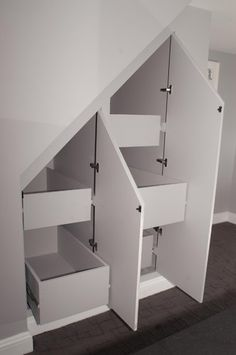 Cabinets with built in drawers under stairs | Storage Ideas