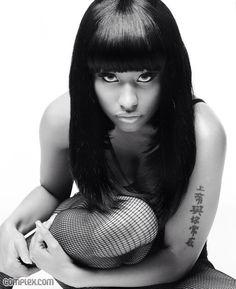 Image from https://www.clichemag.com/wp-content/uploads/2015/03/Nicki-Minaj-tattoos.jpg.