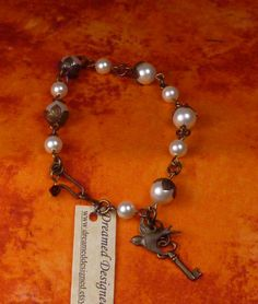 Vintage brass and pearl toggle bracelet with antique brass key