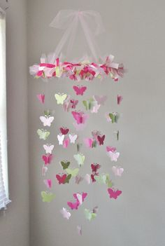 Butterfly Chandelier Mobile in Light pink, dark pink, and grassy green by RustyAnchorPrints on Etsy https://www.etsy.com/uk/listing/156237809/butterfly-chandelier-mobile-in-light