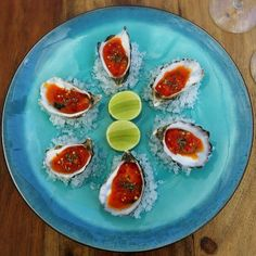 Harissa oysters over a glass of wine. Who could say no to that?! Enjoy your weekend, friends!  www.moorishblue.com
