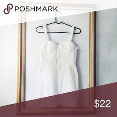 White denim pinafore dress White denim pinafore dress with bustier top and adjustable straps. It's 98%cotton and 2 %spandex. Perfect summer dress for any occasion Nasty Gal Dresses Mini