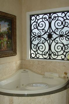 Tableaux faux iron on a frosted bathtub window. Hmmm.. Could be a good temporary solution until we renovate and have that pretty scottish glass installed.