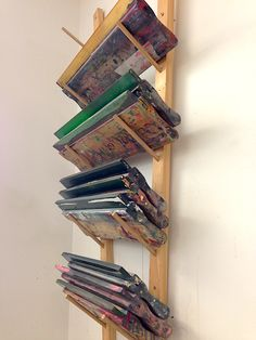 Vis i rack for large rolled documents such as blueprints plans associate professor at the university of denver catherine chauvin uses a custom wooden rack for squeegee storage great storage enables students to access malvernweather Choice Image