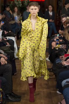 Vetements Spring 2016 - Floral: Similarly to McQueen, Vetements uses minimalist and decorative florals in the Spring trends. Vetements overlaps the frills/ruffles trends.