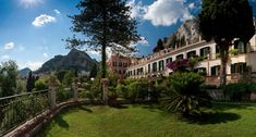 High in the hills of Taormina with views of Sicily's volcanic coastline and Mount Etna, Grand Hotel Timeo is surrounded by ancient architecture and the perfectly blue Mediterranean.