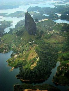 The Rock of Guatape or Stone of Peñol, is a monolith of 220 meters of height located in Guatapé (Antioquia, Colombia). The Stone of El Peñol, composed of quartz, feldspar and mica, was first climbed on July 16, 1954 by an inhabitant of the area, Luis Eduardo Villegas López. in the company of Ramon Diaz and Pedro Nel Ramirez. Currently, it is possible to access its summit by climbing 740 steps built on the monolith.