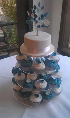 Wedding cupcakes with a leaf on top - not these colors, but concept