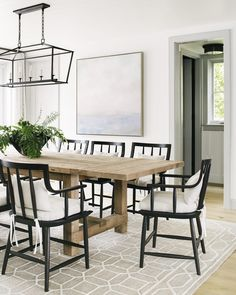 neutral dining room design, modern dining room design with white walls and modern farmhouse dining room table with chandelier and black modern dining room chairs and lantern chandelier, modern coastal dining room Light Wood Dining Table, Reclaimed Wood Dining Table, Black Dining Chairs, Chairs For Dining Table, Farmhouse Dining Chairs, Black Kitchen Chairs, Black Wooden Chairs, Transitional Dining Chairs, Black And White Dining Room