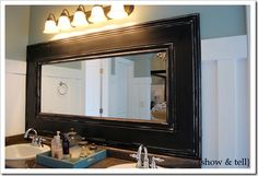 Framed mirror for bathroom, this is such a good idea for those large sheet mirrors the builder hangs in the bathroom