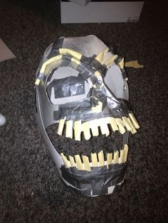 http://www.instructables.com/id/How-to-make-a-Scary-Scarecrow-Mask-With-Moveable-/step4/TEETH/