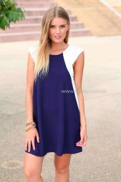 Super cute, white and navy loose dress. Perfect for Conformation or Homecoming.