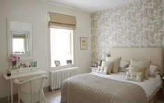 Soft 'n pretty guest bedroom in muted shares of gold, cream and white