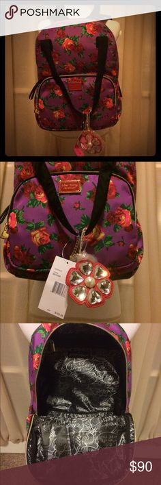 "NWT Betsey Johnson purple backpack w/ red roses  NWT Betsey Johnson purple backpack with red roses  this bag is absolutely gorgeous! Has detachable flower charm, along with being a backpack it also has straps on the top. Large front zip pocket, open slots on both sides & large interior with 1 large zip pocket & 2 open slots. Very spacious! Measurements: height 15.5""; length 11""; depth 7""; & strap drop 8"". Original price $108, reasonable offers warmly welcomed  Betsey Johnson Bags Backpacks"