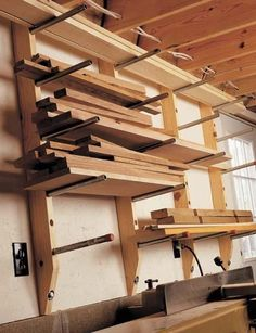 $30 Lumber Storage Rack ... using a few pieces of pipe & some 2 x 4s, you can get all your rough lumber & off-cuts organized ... it's adjustable............... #DIY #storage #lumber #wood #pipe #adjustable #plans #howto #tools #garage #crafts