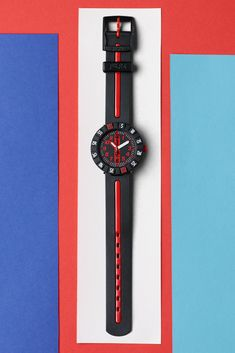 """This plastic Swiss made watch suggests that red might actually mean """"don't stop!"""". It's a stylish black and red analogue watch for kids that would make a great gift, signaling sporty sophistication. With its sharply contrasting colour-coded details, RED AHEAD (ZFCSP079) has a bold look that's always one step ahead of the rest. Swiss Made Watches, Swatch, Great Gifts, Rest, Clock, Sporty, Plastic, Stylish, How To Make"""