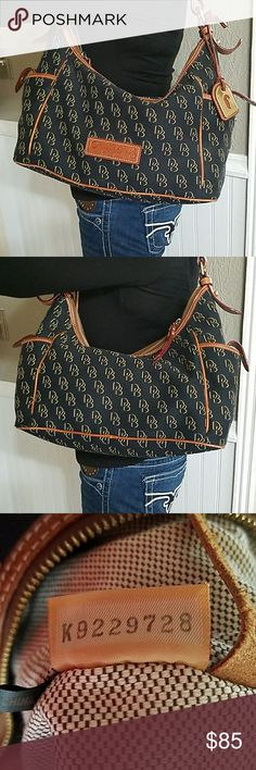 "Dooney and Bourke shoulder bag D&B bag in EUC. There are a few stains on the inside as seen above.  Height 8""  Width 15"" Shoulder drop 15"" Dooney & Bourke Bags Shoulder Bags"
