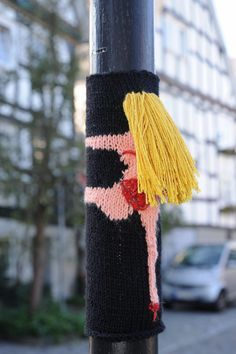 yarn bombing Respect sex workers tag. Graffiti which is totally reversible, harmless and humorous.