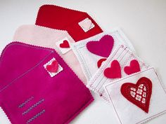 """Felt Play Valentines:  1/3 yard of red, pink, and magenta felt 1/4 yard of white felt  disappearing ink pen   thread  hot glue or tacky glue  print template out on cardstock and cut out (click here for template PDF)     Finished Size: 6.25"""" x 5.5"""""""